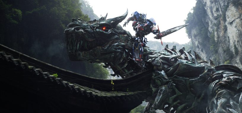 Left to right: Grimlock and Optimus Prime in TRANSFORMERS: AGE OF EXTINCTION, from Paramount Pictures.